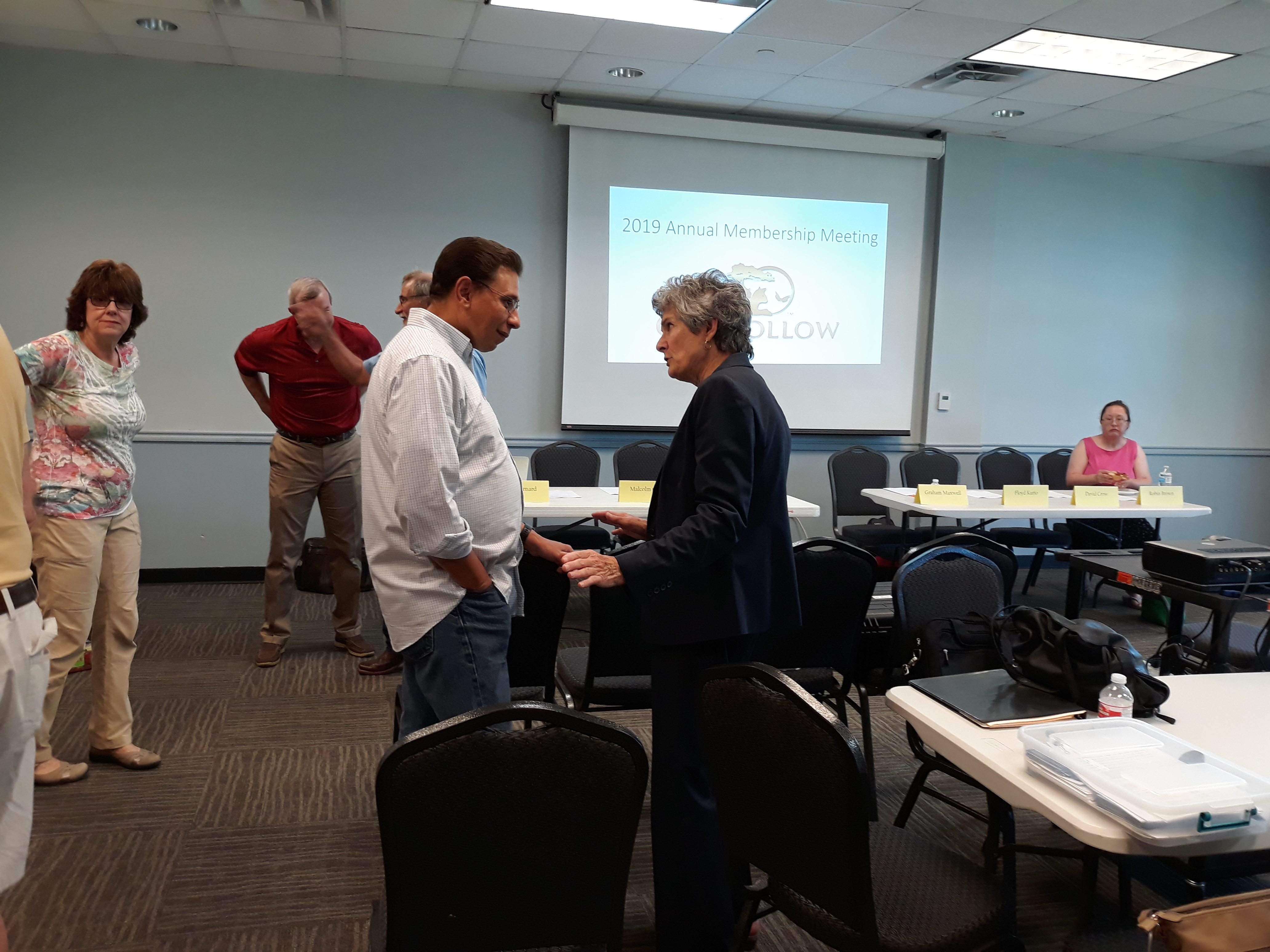 Commissioner Cook confers with HOA Board President Graham Maxwell before the meeting begins.