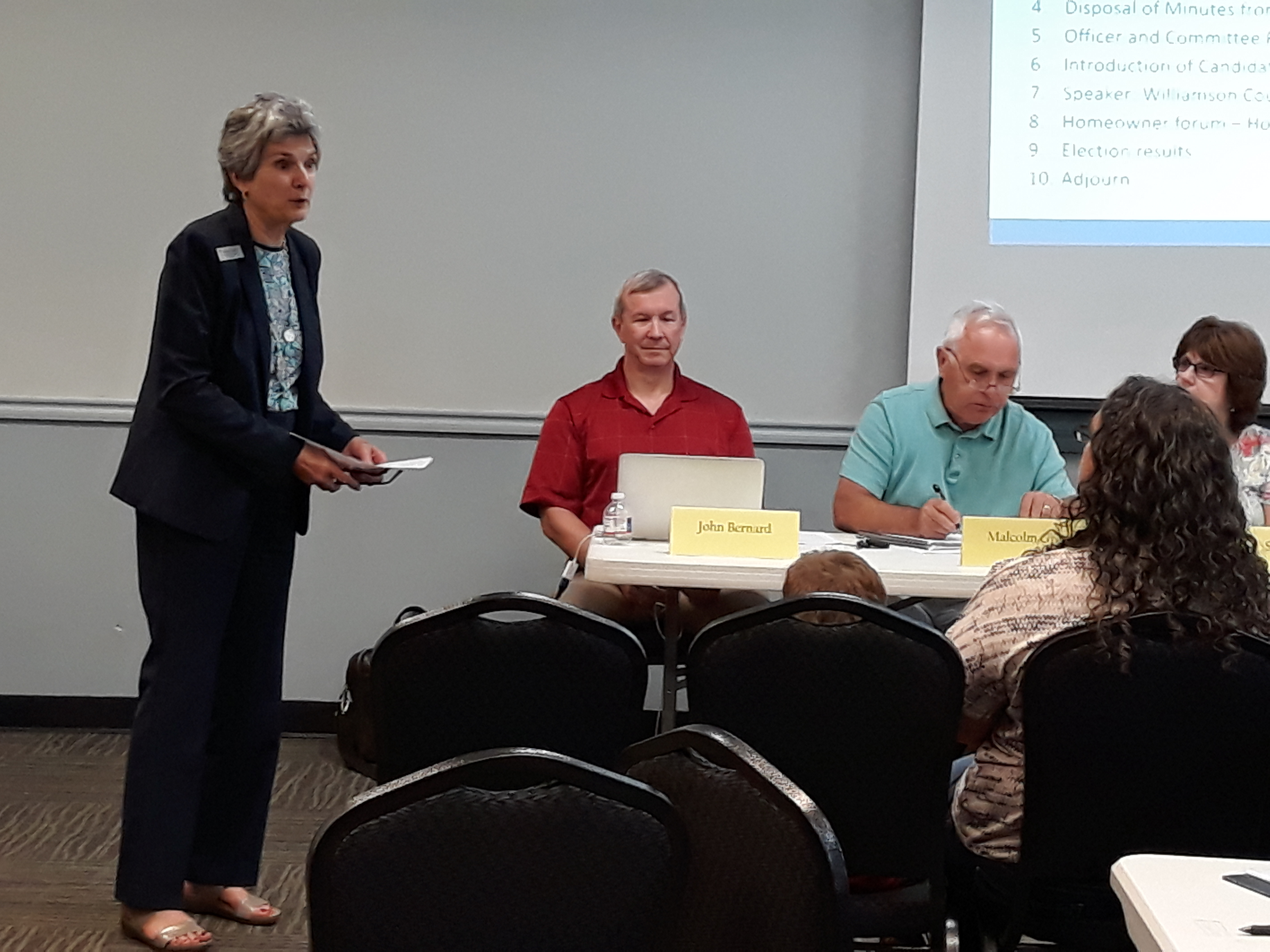 Commissioner Cook speaks to the HOA Board and residents about local issues regarding forthcoming traffic signals, chip seal, Apple and Robinson Ranch's status, and answered questions on street safety and other concerns.