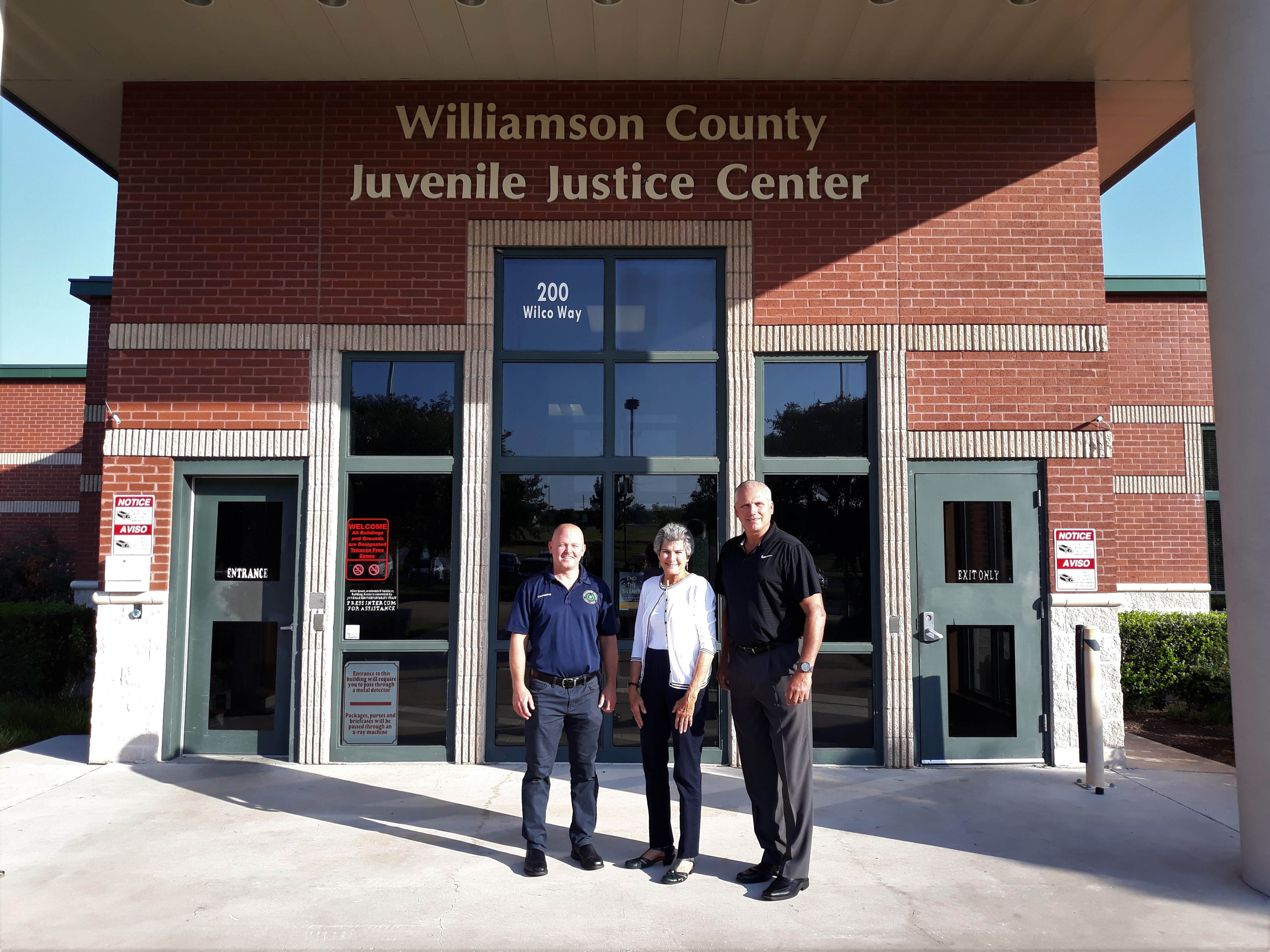 Commissioner Cook arrives at the Williamson County Juvenile Justice Center in Georgetown to meet with Wilco Juvenile Services Assistant Executive Director Matt Smith (left) and Director Scott Matthew (right).
